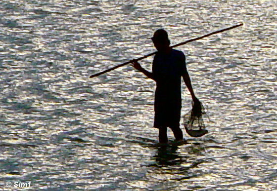 Fishermen with his catch